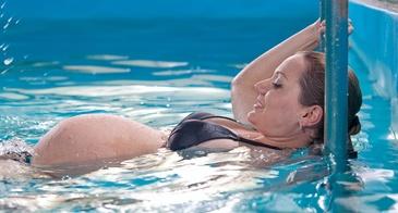 Боль в спине во время беременности