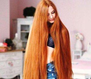 Девушка с очень длинными красивыми волосами - это реальность